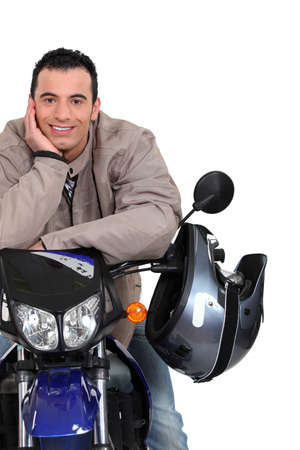 Man with his motorbike photo