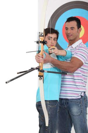 bull     s eye: Boy with archery coach