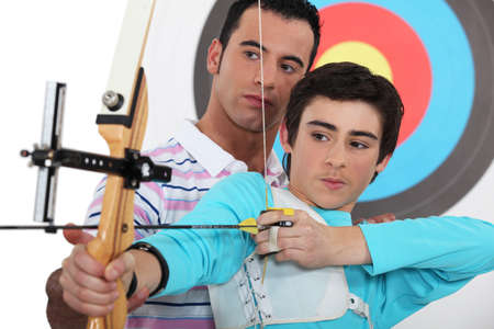 Teen practicing archery Stock Photo - 15225231