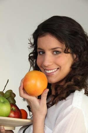 Brunette holding fruit Stock Photo - 15497785