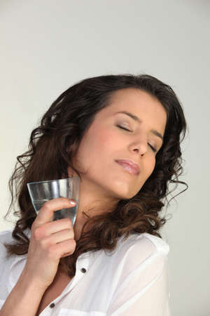 adore: Woman enjoying a cold drink