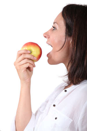 Woman eating an apple photo