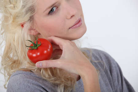 sexy mouth: Blond woman holding tomato