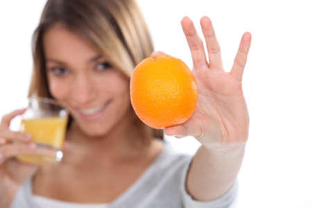 woman drinking a fresh orange juice Stock Photo - 15223855
