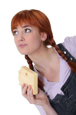 holey: Woman with a block of Swiss cheese Stock Photo