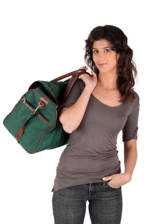 duffel: Woman carrying a duffel bag Stock Photo