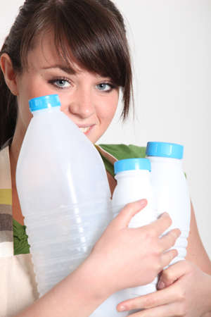 Young woman recycling plastic bottles photo