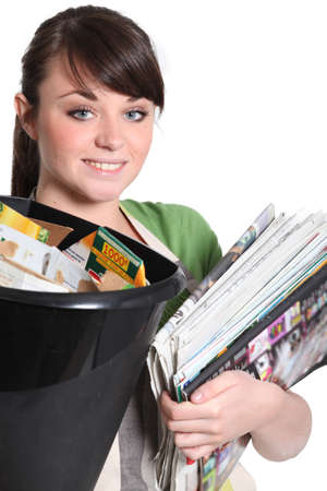 reusing: Young woman recycling paper