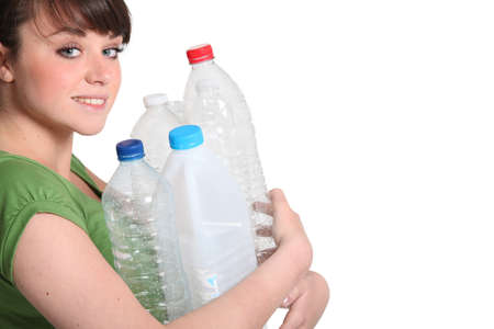 Woman about to recycle photo