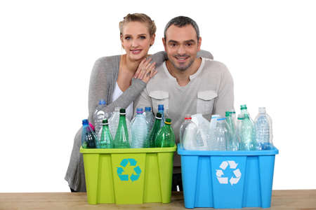 Enthusiastic couple recycling photo