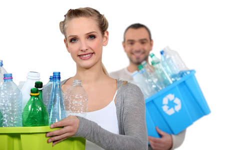 couple recycling plastic bottles Stock Photo - 15496715