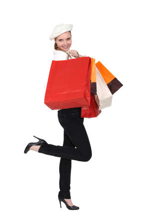 returning: Happy woman returning from shopping trip Stock Photo