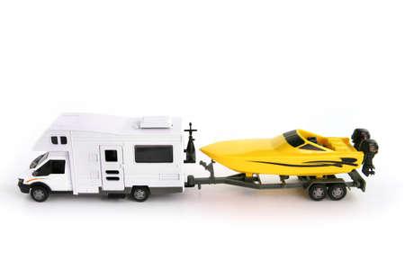 pull toy: Toy camper furgoneta y lancha rápida Foto de archivo
