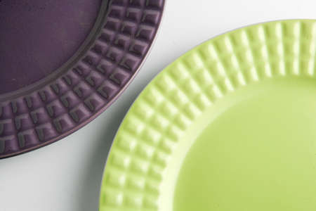 arranging: purple and green plates