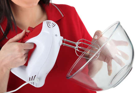 beater: a woman using an electric beater