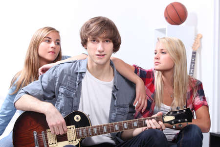 Teenagers playing the guitar Stock Photo - 15224941