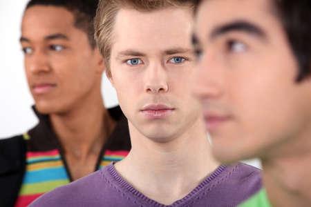 black hair blue eyes: Portrait of three teenagers
