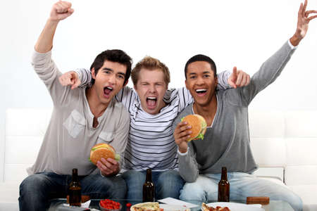 cheering people: Friends watching a football game together