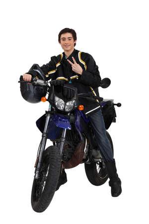 scrambler: Lad on a motorbike
