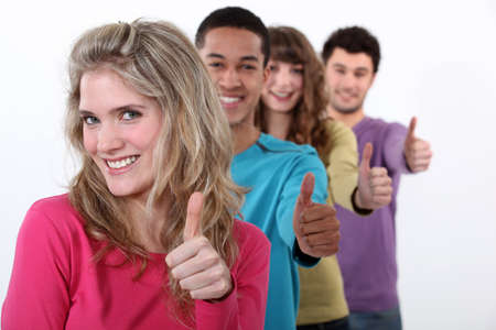 concurrence: Young group of people giving the thumbs up Stock Photo