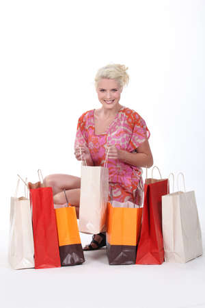 spendthrift: gorgeous blonde with shopping bags isolated on white