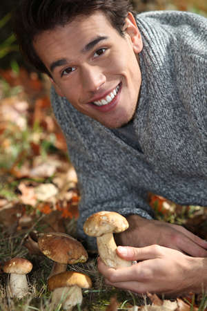 Man picking mushrooms photo