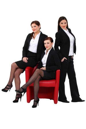 black pants: Three elegant women Stock Photo