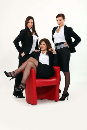 three sexy woman in a suit photo