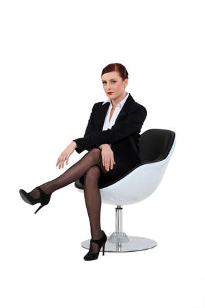 designer chair: A businesswoman on a chair.