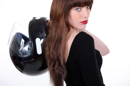 Woman with motorcycle helmet photo
