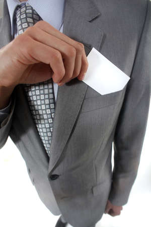 Businessman pulling a business card out of his pocket Stock Photo - 15496506