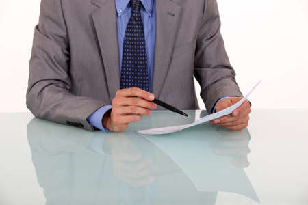 verifying: Close-up of man proof reading a document Stock Photo