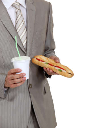 Businessman holding sandwich and soft drink photo