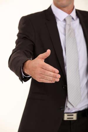 comunicacion no verbal: De negocios que sostiene su mano para un apretón de manos Foto de archivo