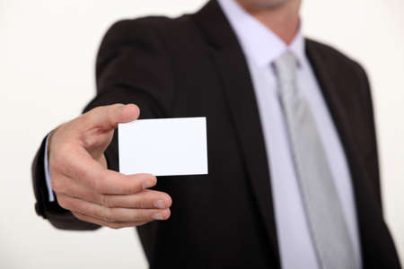 businesscard: Cropped executive with a blank businesscard Stock Photo