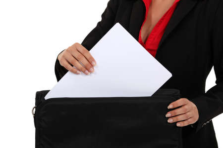 Lawyer pulling a document out of her briefcase photo