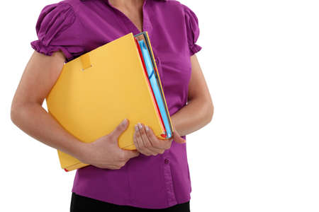 A cropped picture of a businesswoman holding  a file. photo