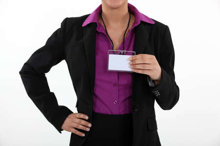 colloquium: Woman holding a blank name tag Stock Photo