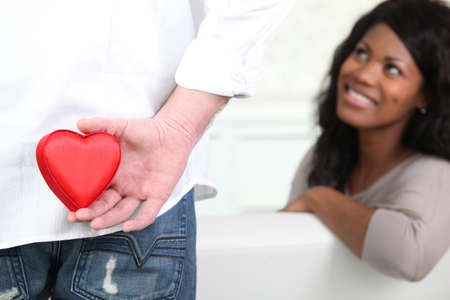 Man about to give his heart to his girlfriend photo