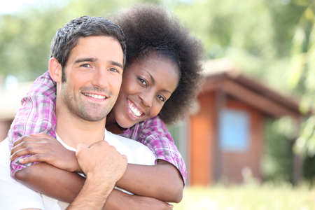 interracial couple embracing photo