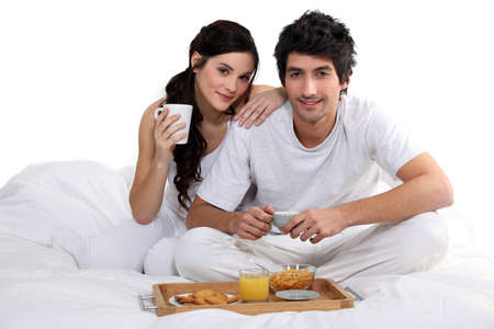 Couple having colazione a letto photo
