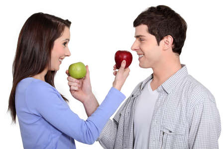 unbuttoned: Couple giving each other an apple
