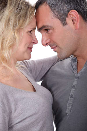 seductive expression: Lovers gazing into each other Stock Photo
