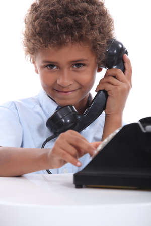 7 years old: Boy on the phone