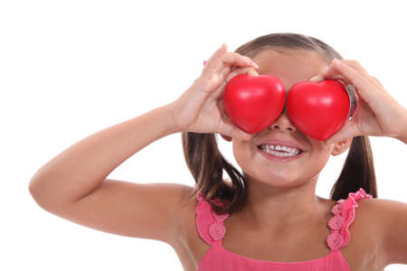 blind child: portrait of a little girl holding hearts