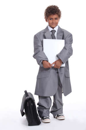 Little boy dressed in business suit photo