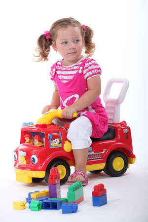 3 5 years: Girl on fire engine Stock Photo