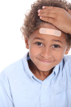 Little boy with plaster on head photo