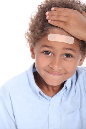 unworried: Little boy with plaster on head