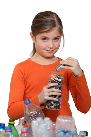 Girl recycling batteries photo
